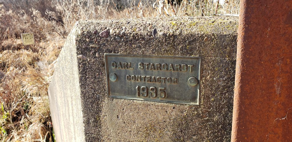 a plaque on a bridge showing that it was built in the 1930s